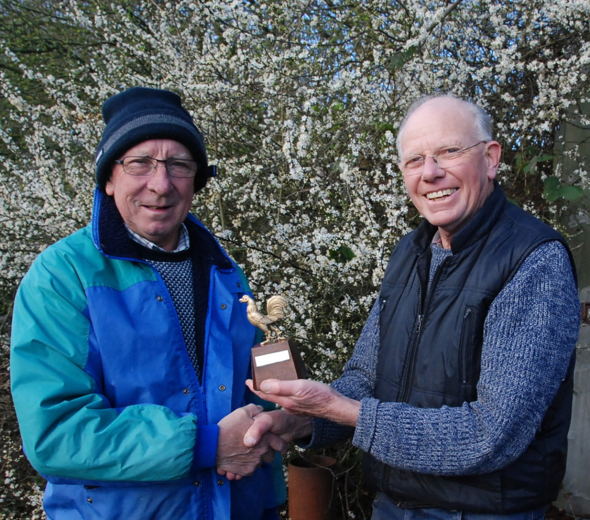 Martin Crysell(Left) receiving the Courage Cock trophy from Roger Stollery